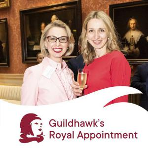Photo of Guildhawk CEO, entrepreneur and software coder Jurga Zilinskiene MBE and Rita Metlovaite Head of Client Business Transformation, Guildhawk attending a Royal Appointment at Buckingham Palace Reception as the Winners of the Queens Award for International Trade.