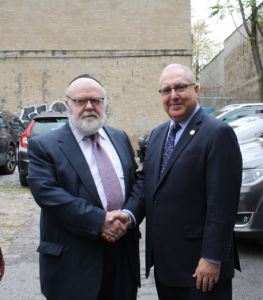 Dr. Joshua Weinstein (left), Assemblyman Steven Cymbrowitz (right) outside of SKHOV