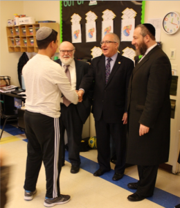 Dr. Joshua Weinstein (left), Assemblyman Steven Cymbrowitz (middle), Mr. Ezra Freidlander (right) meeting students at SKHOV