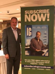 Doug Laney father of Infonomics stands next to his banner at the information governance and infonomics summit in new york city