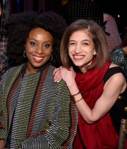 Chimamanda Ngozi Adichie smiling to camera next to Equality Now Global Director Yasmeen Hassan