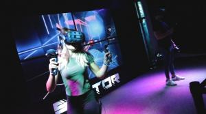 Beat saber VR in mixed reality, girl and boy playing VR in Sektor