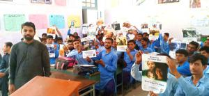 Students at a government school near Islamabad hold up posters with the articles of the Universal Declaration of Human Rights included in the educators' package available through the Youth for Human Rights website.
