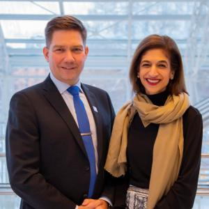 Thomas Blomqvist, Finland's Minister for Nordic Cooperation and Equality & Equality Now's Yasmeen Hassan, standing next to each other, smiling, looking to camera