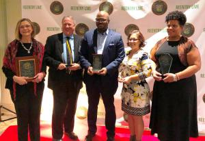 Criminal justice advocates and officials awarded for working to improve results for citizens returning from incarceration.  (Left to right) Myra Woods, Reunion DC; John Stanard, Director of Social Betterment Programs & Policy for the Church of Scientology