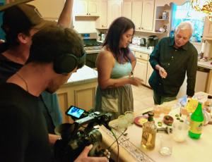 "Film crew taping visual artist, Celeste De Luna, with author Adán Medrano in a scene from new indie documentary, ""Texas Mexican Food Stories."""