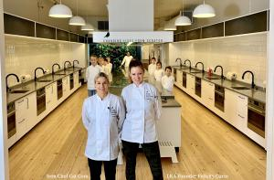 Photo of Iron Chef Cat Cora & LKA Founder, Felicity Curin standing in Little Kitchen Academy together in chef coats