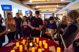 In the Church of Scientology of Tampa's chapel, attendees of last year's Holocaust Remembrance Day light candles before a moment of silence.