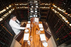 There is nothing more romantic than dining under a waterfall of wine bottles in TRIBUTE's exclusive wine room.