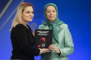 "Ashraf-3, Albania, January 29, 2020 - Mrs. Monika Kryemadhi, Chairwoman of the Socialist Movement for Integration Party, and Mrs. Maryam Rajavi, the NCRI President-elect, holding the recently published book by the Iranian Resistance, entitled, ""Crime Against Humanity"""