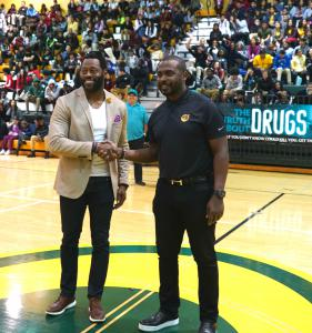 Miamian Nick Ferguson and Foundation for a Drug-Free World spokesperson Marshall Faulk speak to students in Miami's Jackson Senior High gymnasium before the unveiling of the school's new mural with its drug-free message