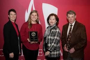 Members of the Tucker family pose with Leah Carpenter, the first recipient of the Tucker Heart, Soul, Mind, and Strength Scholarship. From left, are, Lisa Tucker, Leah, Carolyn Tucker and Robert Tucker.