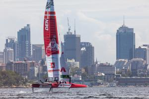 The Denmark SailGP Team cutting through the waters around Sydney