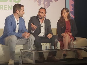 (L-R) Fyllo CEO Chad Bronstein, Driven Deliveries CEO Christian Schenk, and Akerna CEO Jessica Billingsley, speak on a tech panel during the Benzinga Cannabis Capital Conference in Miami Beach, Florida.