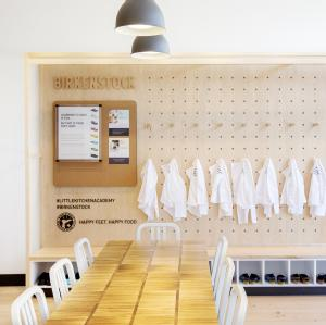 Birkenstock branded wall at Little Kitchen Academy with Birkenstock chef shoes and chef coats