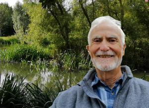 A smiling Krunchie Killeen with the Tolka River & foliage in background