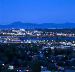 Great Falls MT at night with Rockies in the background