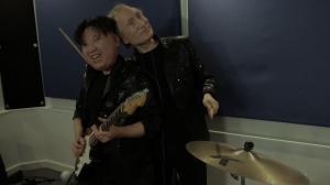 Kim and Putin being affectionate at band practice