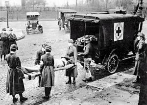 A victim of the 1918 Spanish flu is loaded into an ambulance.