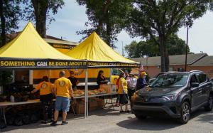 Scientology Volunteer Ministers of Tampa set up their bright yellow tent and handed out hygiene kits to neighbors through the windows of cars to maintain social distancing.