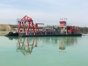 This is a deep digging electric powered mining dredge designed and built by Custom Dredge Works.  This dredge has a long-ladder with an underwater pump mounted on the dredge ladder.  This dredge is meeting or exceeding production expectations.