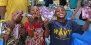 Youth with their DFW booklets at a 2019 summer outreach event