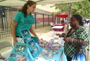 "Thalia Ghiglia, DFW DC Coordinator, sharing drug prevention materials at a 2019 ""Beat the Streets"" event."