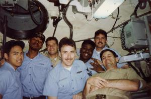 A picture of John Gregory Vincent with his shipmates underway on a nuclear submarine