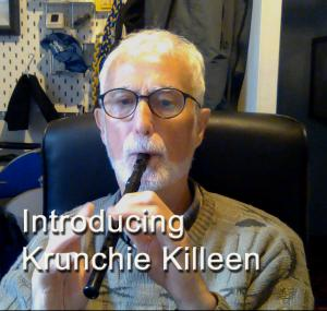 Krunchie Killeen blowing a black tin whistle