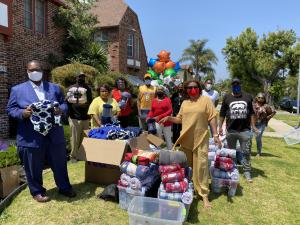 Executive Board and members of the New Frontier Democratic Club deliver 200 blankets