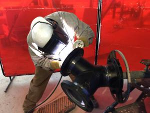 Pipe welder, back welding pipe using a TIG welding process