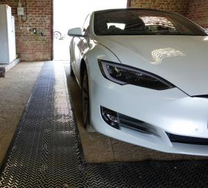 A Tesla Parked on RatMat