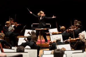 Woman passionately conducting an orchestra
