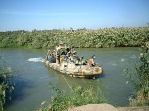 Boat with soldiers on a river