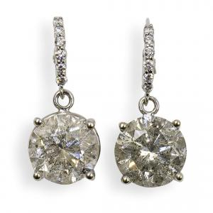 Pair Of 10 Carat Diamond and Gold Stud Earrings
