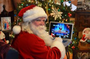 Santa uses his computer to talk to the children of the world