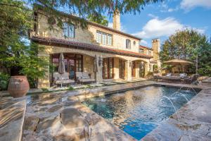 A Turtle Creek resort-style home with pool, cabana, & full bar.