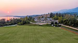 Atop a private 20-acre oceanview bluff, this Mediterranean-style mansion, featured in a Britney Spears music video, boasts 43,000± square feet of luxury living.