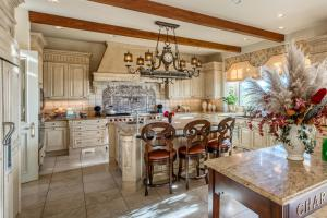 An enormous, spectacular kitchen with limestone fireplace and sitting area can accommodate several chefs at once.