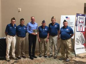Bryan Keller pictured with Defiance County Veterans Service Commissioners holding award