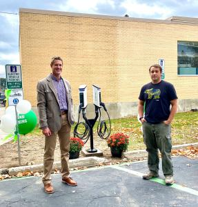 Pend Oreille PUD's Colin Willenbrock and the Greater Newport Area Chamber of Commerce's Jason Totland with SemaConnect EV charging stations