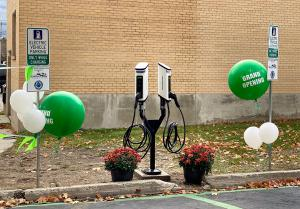 SemaConnect Series 6 smart networked EV charging stations on dual pedestal with green Grand Opening balloons at Pend Oreille PUD's Newport Administration Building