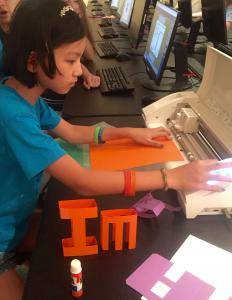 Girl student using web-based FabMaker STEM program to design and fabricate inventions