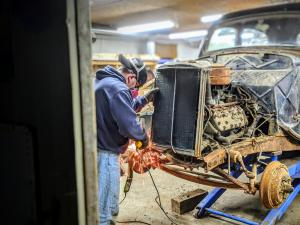 Jason Ludwin welding in his shop on his 1936 Ford Sedan