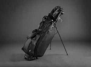 The VESSEL Player III stand bag is shown in the black colorway. It is paired with matching all-black golf head covers.
