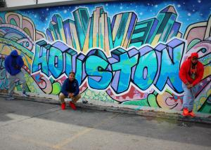 The BOHUP Crew in front of Houston graffiti