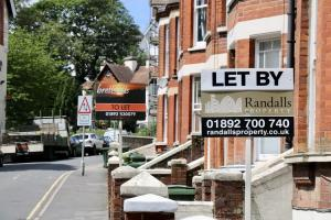 To let signs on a street of red brick houses in the UK