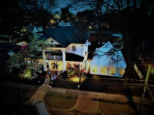 A birds eye view of The Cigar Mansion at night.