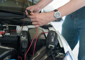 CTEK MXS 5.0 Battery Charger hooked to car battery