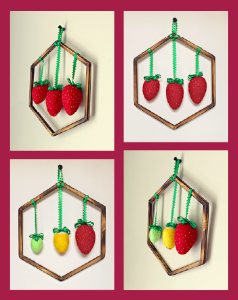 Handmade felt strawberries, framed with handcrafted wooden hexagons help these wallhangings bring whimsy and fun to small spaces.